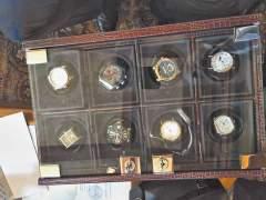 ... а также коллекцию часов, оружия и многое другое